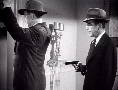 Chandler's Law - if you get stuck have a man come through the door with a gun.
