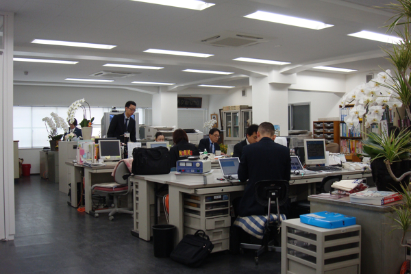 A real Japanese office. Notice the two ninja cunningly disguised as a wastepaper basket and bag.