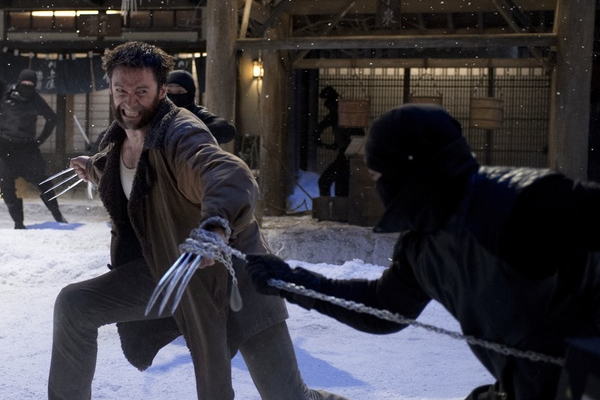 Hugh Jackman closely avoids getting a sword up the bum.