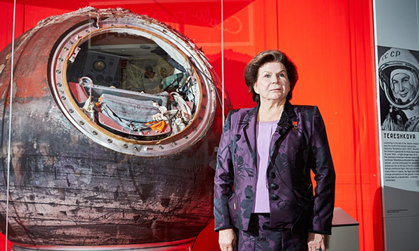 Valentine Tereshkova, first woman in space, stands next to her capsule at opening of the exhibition.